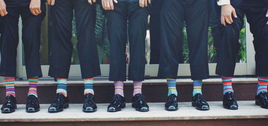 Wearing colorful dress socks adds a touch of flair