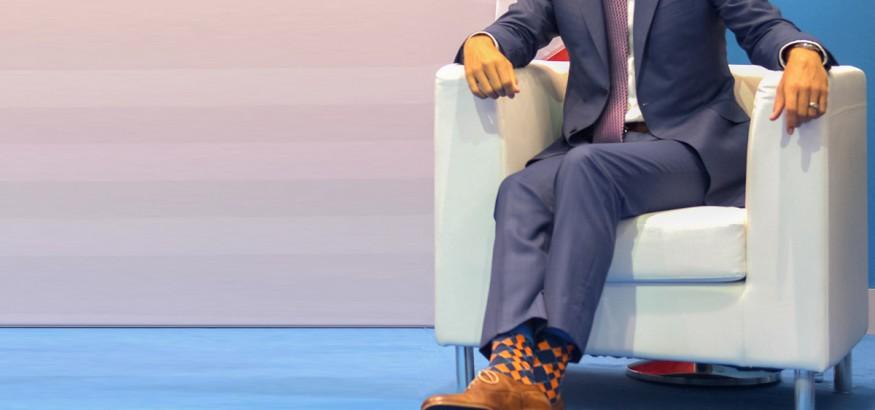 Politician wearing funky dress socks